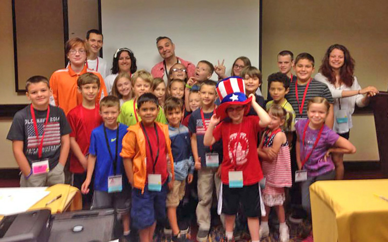 Group photo of me with the kids who I taught cartooning at the NSA annual conference in July 2014